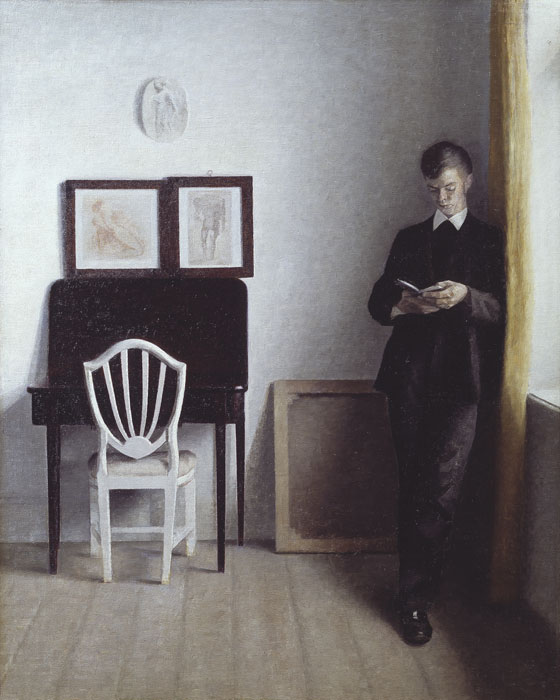 Vilhelm Hammershøi (1864-1916), Interior with a Young Man Reading